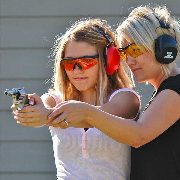 mother and daughter practice shooting